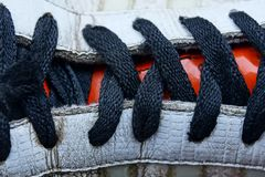 Black shoelaces on a colored leather boot. Part of a leather shoe with a black lace Royalty Free Stock Photos