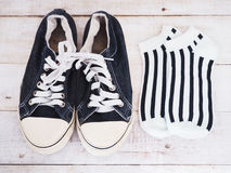 Black Shoes And Striped Socks Stock Image