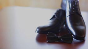 Black shoes and bow tie stock video