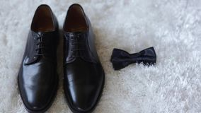 Black shoes and bow tie stock footage