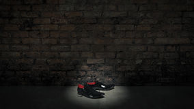 Black shoes and bricks wall Royalty Free Stock Photography