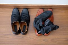 Black shoes and brown male shoes with socks. Top view of black shoes and brown male shoes with socks Royalty Free Stock Photo