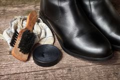 Black shoes with brush and polish cream Stock Photography