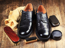 Black  shoes with care accessories Royalty Free Stock Images