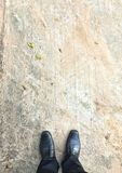 Black shoes on concrete Royalty Free Stock Photography