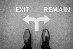 Black shoes at the crossroad - exit or remain Stock Image