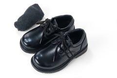 Black shoes with grey socks. Black boys school shoes with grey socks Royalty Free Stock Photos
