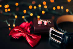 Black shoes of the groom, red bow tie, cufflinks, belt, on a bla Stock Photography