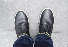Black shoes on the ground Royalty Free Stock Image