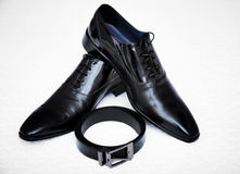 Black shoes man. Belt and black shoes fashion man Royalty Free Stock Images