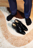 Black shoes beside man feet with black socks Stock Images