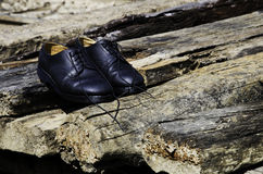 Black shoes. Black shoes on a pile of wood Stock Photography