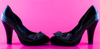 Black shoes on pink Royalty Free Stock Photos