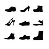 Black shoes silhouettes. On white background Stock Photography
