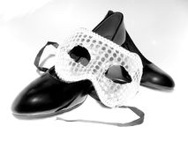 Black shoes with silver mask Stock Photography