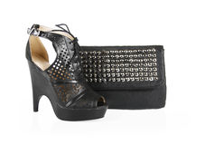 Black shoes and spiked bag Royalty Free Stock Images