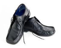 Black shoes stacked. A pair of black shoes royalty free stock photos