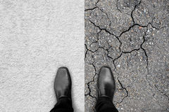 Black shoes standing on carpet and earth. Black shoes standing, left foot on white carpet and right foot on dry earth. Represent two different ways like easy or Stock Photo