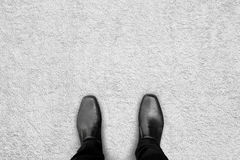 Black shoes standing on the carpet Stock Image