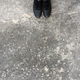 Black Shoes Standing on the Concrete Floor Stock Images