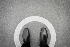 Black shoes standing in white circle Stock Photo