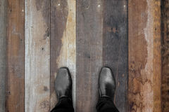 Black shoes standing on wooden floor Royalty Free Stock Photography