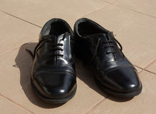 Black shoes in the sun. Black shoes drying in the sun stock image