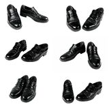 Black shoes in various positions with scuff marks isolated on white. A pair of black men's shoes in various positions with scuff marks isolated on a white Royalty Free Stock Images