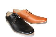 Black shoes versus Brown shoes Stock Photo
