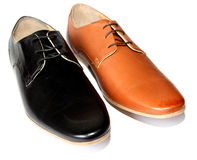 Black shoes versus Brown shoes Royalty Free Stock Image