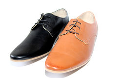 Black shoes versus Brown shoes Royalty Free Stock Images