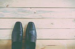 Black shoes on wooden background. Top view. Stock Images