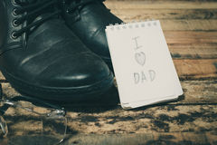 Black shoes with word love dad. On notebook Stock Photo