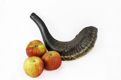Black Shofar with apples. Shofar is a Jewish traditional symbol. It is a custom to blow the shofar on Rosh ha Shana stock photo