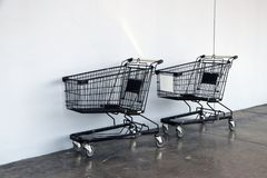 Free Black Shopping Cart On The Floor And White Background. Trolley Is A Cart Supplied By A Shop, Especially Supermarkets. Stock Photo - 114263650