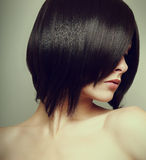 Black short hair style. Sexy female model. Vintage portrait Stock Photography
