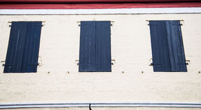 Black Shutters in Stucco Wal Stock Image