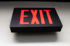 Black sign that reads EXIT in red letters royalty free stock photography