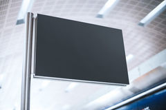 Black signboard on the metal post Stock Photography