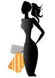 Black silhouette. Girl with purchases. A harmonous female figure. Black silhouette Stock Image