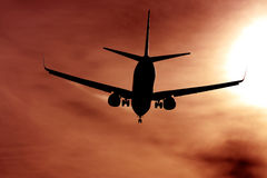 Black silhouette of airplane against the sun Royalty Free Stock Photo