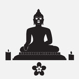 Black silhouette of Buddha with candle and flower Royalty Free Stock Photo