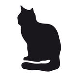 Black silhouette of cat. Black side silhouette of a sitting cat on a white background Royalty Free Stock Image