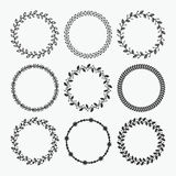 Black silhouette circle leaves emblems set on white background Stock Images