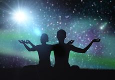 Black silhouette of couple meditating over space Stock Photos