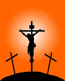 Silhouette of a crucifix. Black silhouette of a crucifix on the orange background Stock Image