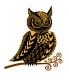 Black silhouette of a eared owl with yellow ornament Royalty Free Stock Images