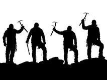Black silhouette of four climbers with ice axe in hand Royalty Free Stock Photo