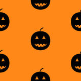 Black silhouette funny smiling pumpkins. Cute cartoon baby character. Happy Halloween. Seamless pattern. Orange background.  Stock Image