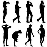 Black silhouette group of people standing in various poses.  Royalty Free Stock Photography